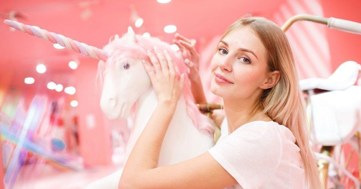 Unicorn Name Generator - Woman and White Unicorn